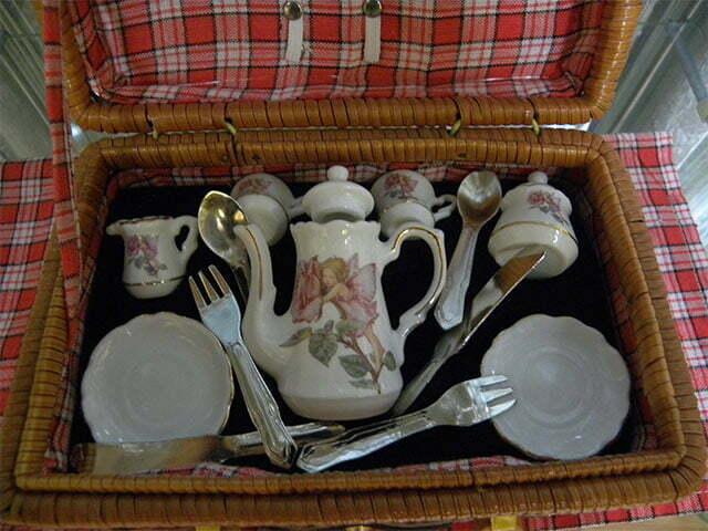 Dinnerware in picnic basket.